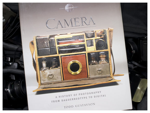 the cover for todd gustavson's camera book