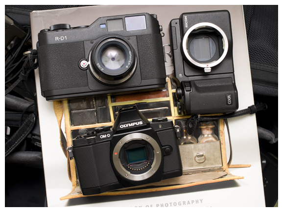 the cover for todd gustavson's camera book with size comparison