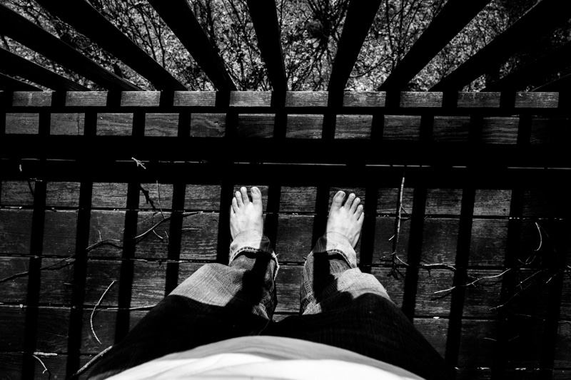 wide angle shot of feet with dramatic shadows