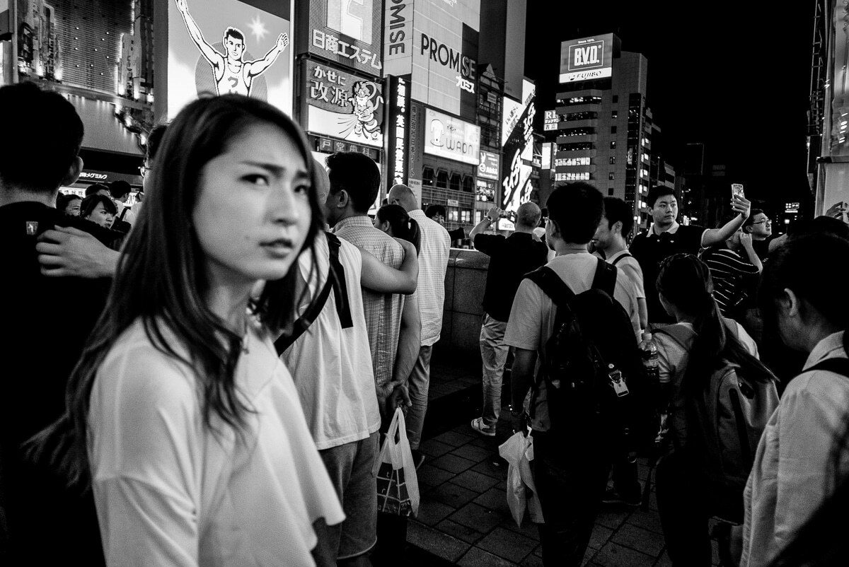 Osaka street photograph with a woman looking suspiciously