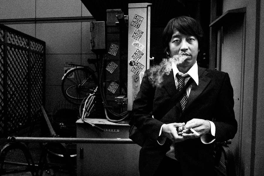street photography example image of a man smoking